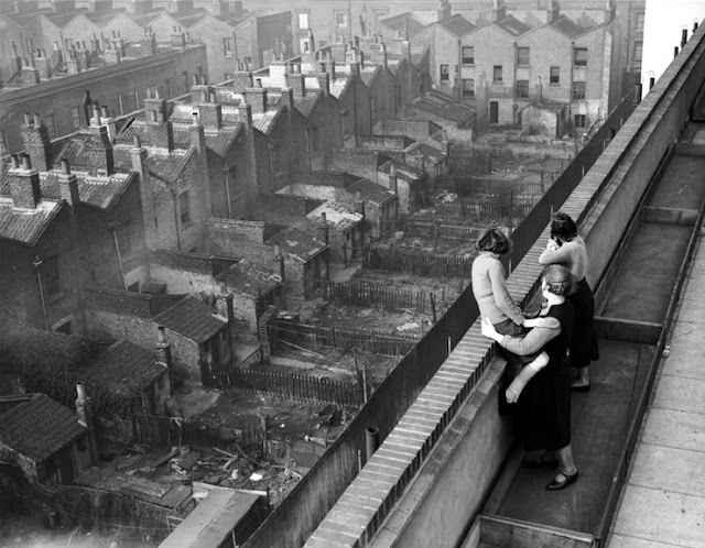 London A woman and her two daughters rooftopping Hillcott House, Haggerston, London 1938