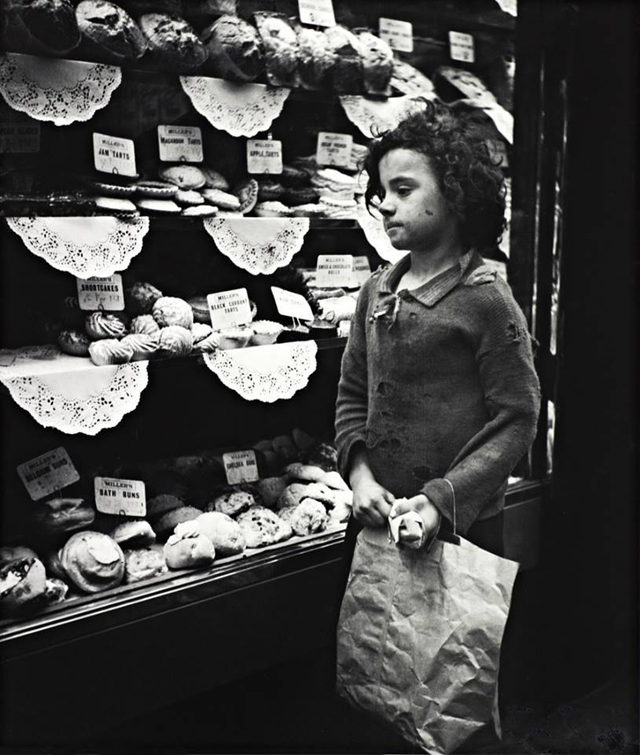 London Child staring into bakery window, London, 1935
